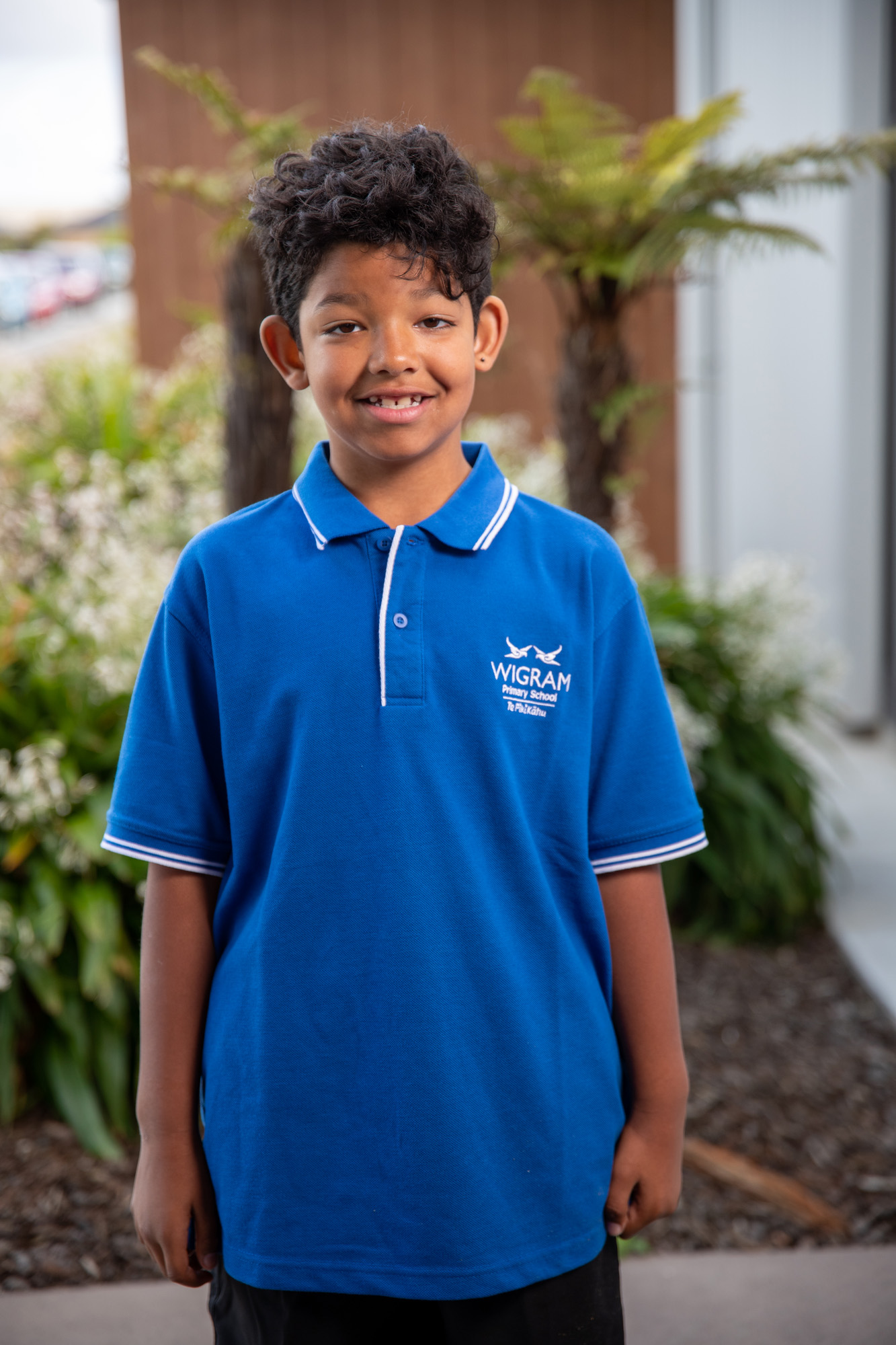 young male Wigram Primary student in blue polo shirt and black shorts
