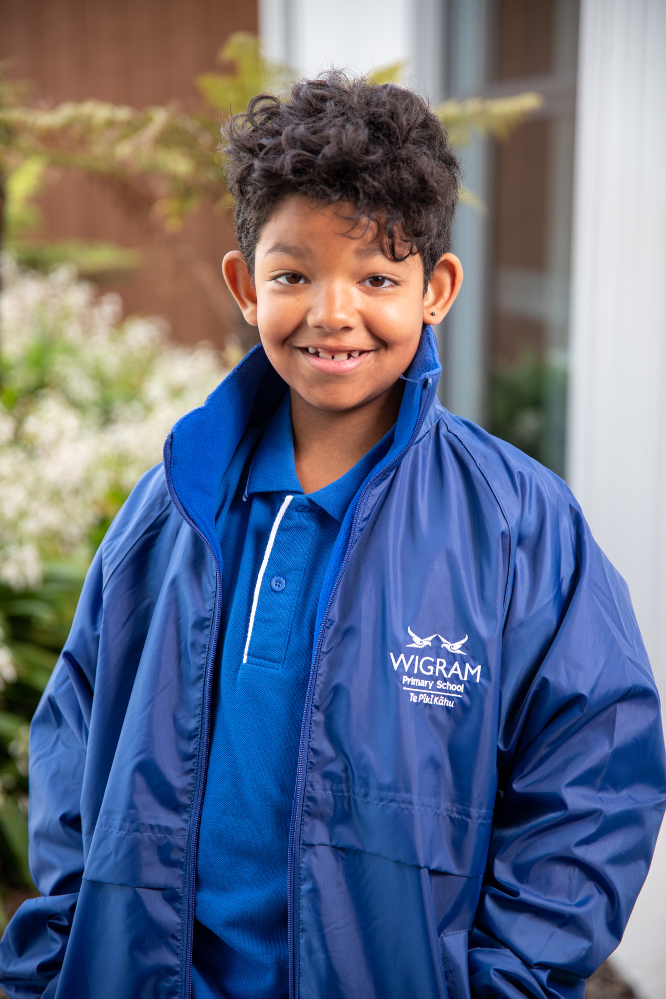 young male in blue shirt and jacket