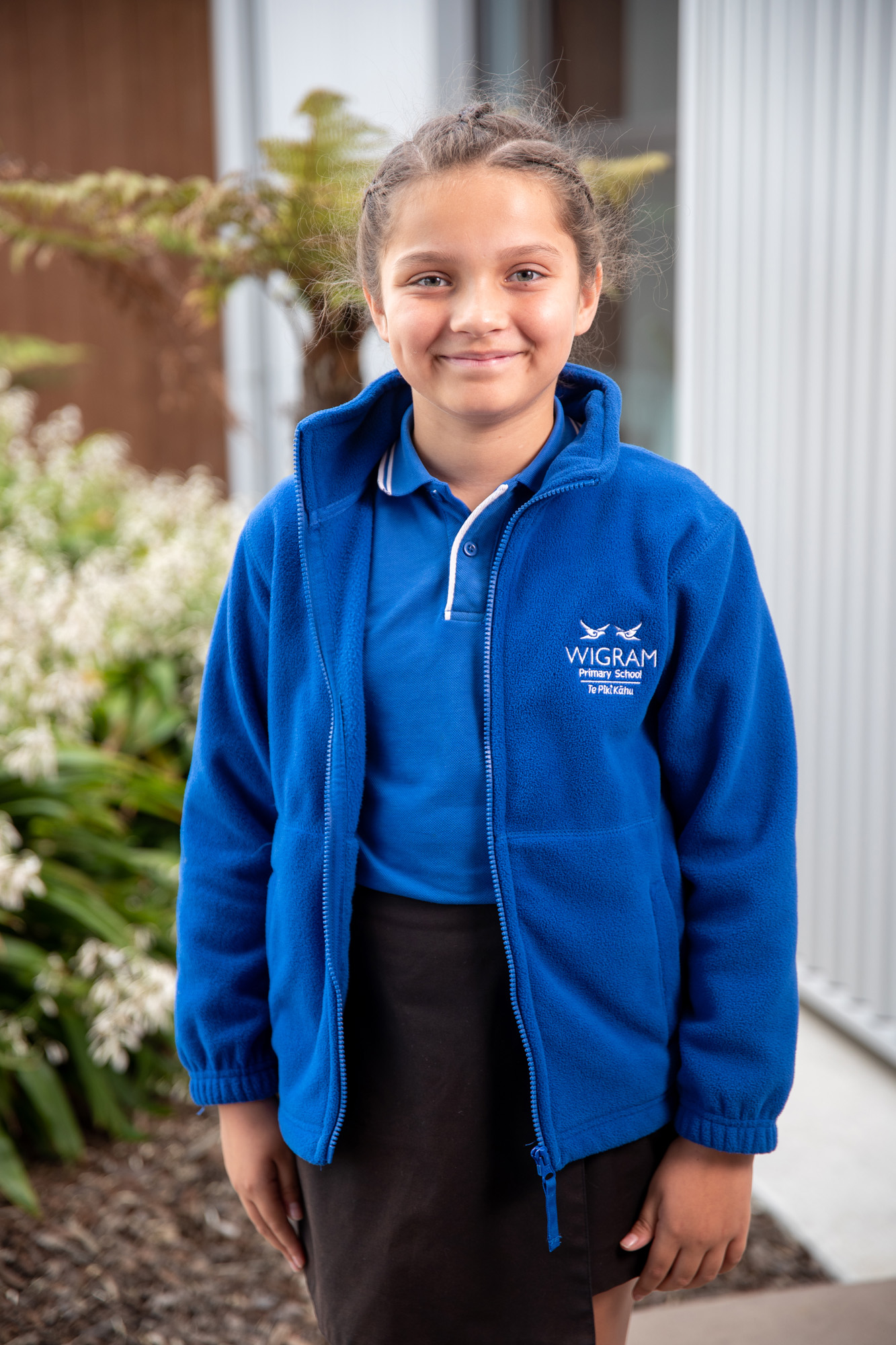 wigram primary blue polo shirt and blue fleece worn by female student