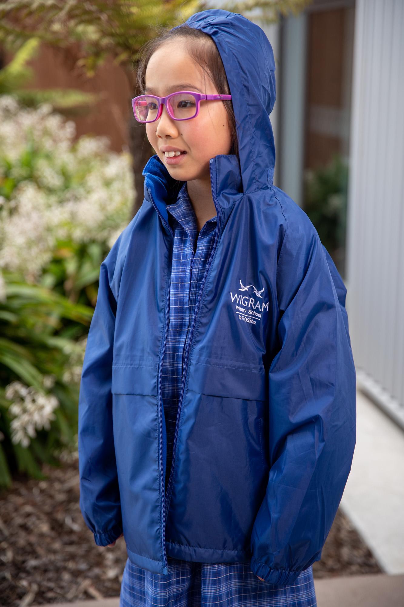 female Wigram Primary student wearing purple glasses and blue rain jacket