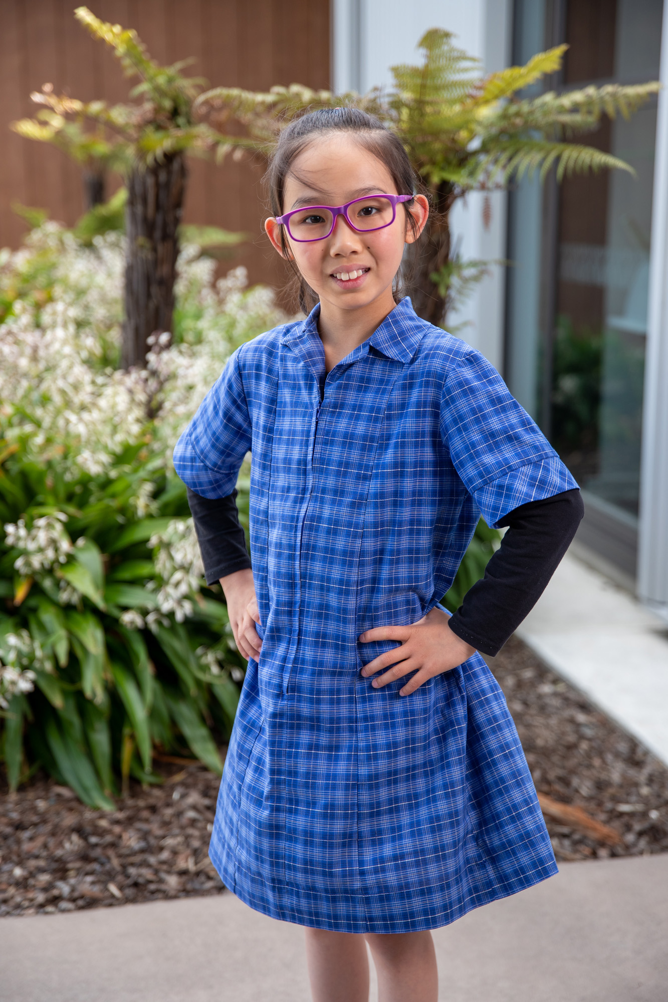 female Wigram Primary student in blue dress and purple glasses